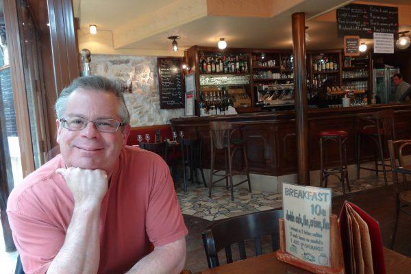 Happy in a café on Rue Mouffetard